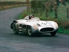 Stirling Moss and Mercedes 300 SLR winner at 1955 Tourist Trophy