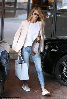 Rosie Huntington-Whiteley looked rather lovely as she emerged fro…