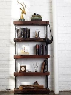 Combine reclaimed wood and galvanized black pipe to create a rugged bookshelf that adds texture and warmth to any room. Get the step-by-steps on HGTV.com.
