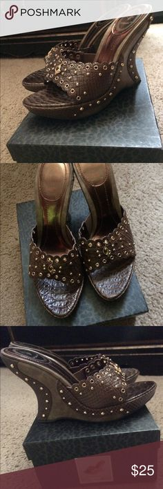 Baby Phat wedges Baby Phat wedges Brown with gold studs Size 9, however they run small I'm a size 7 and these fit me perfect Worn only once! Baby Phat Shoes Wedges