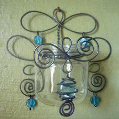 Recycled Jar curled wire wall sconce