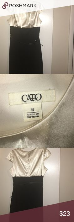 Cato Size 16 Business Dress Cato Size 16 Business Dress. Top is a shiny, cream color made of polyester material. Bottom is solid black polyester bottom. Bottom measures 26 inches. Zipped back. Includes black belt. Cato Dresses