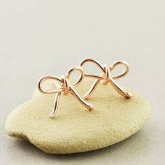 Hey, I found this really awesome Etsy listing at https://www.etsy.com/listing/173733300/bow-studs-rose-gold-bow-earrings-rose