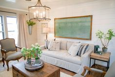 The new living room in the King home is open and spacious. Walls have been removed, creating a much more open feel. Shiplap has been put in and new wood floors have been installed, as seen on Fixer Upper.