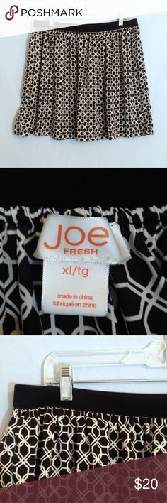"Joe Fresh Black & White Graphic Print Mini Skirt Joe Fresh black & white graphic print mini skirt. Wide black elastic waistband. Size XL, 100% polyester, silky and flowy. Measurements: waist 17 1/2"", hem width 33 1/2"", waist to hem 18"". Joe Fresh Skirts Mini"
