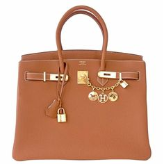 The Herms Birkin Celeb Fave Togo Hardware Iconic Simply Divine Gold Tote is  a top 10 member favorite on Tradesy. 79fcb4df04
