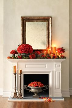 Rustic Romance  Cast-iron urns can barely contain the abundant Leonidas roses and fiddlehead ferns. Garlands made with Hypericum berries and bay leaves add a holiday feel.    Photo by Gemma Commas, styling by Jen Everett      Read more: http://www.oprah.com/home/Genius-Hands-On-Holidays/8#ixzz23TiZOrM5