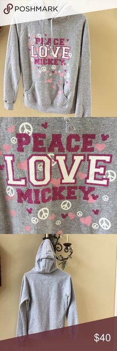 """Disney PEACE LOVE Mickey Pullover Hoodie Size M This is a hard to find Disney Parks Disneyland Disney World Pullover Hoodie It features """"LOVE PEACE MICKEY"""" in Pink Glitter with Peace Signs, Hearts and Mickey's  It is in Like New Condition  Made of 75% Cotton 25% Polyester  Color is Gray with Pink and White Graphics Size is Medium Chest is 38"""" (19"""" flat across) Length 23"""""""" From bottom of hood down center of back  All designer sizing is not the same, if you are not sure of your size  Please…"""