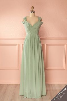 Laticia Green #boutique18161 / This lovely evening gown will satisfy your desires for elegance and refinement. The delightful details of the pleated bodice and the off-shoulder sleeves are in line with the graceful style of this dress. The padded cups and boning in the bodice help in creating a perfect fit.