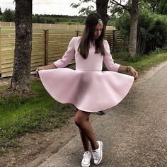 Jaroslava in neoprene dress by Coo Culte