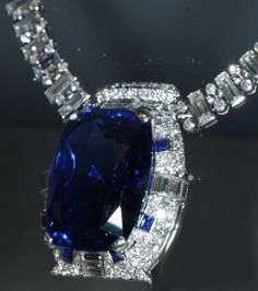 This is the Bismarck Sapphire Necklace with a 98.6 carat sapphire. The deep blue sapphire is surrounded by 312 diamonds.