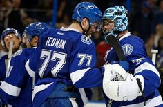 TAMPA, FL - FEBRUARY 5: Victor Hedman #77 and Ben Bishop #30 of the Tampa Bay Lightning celebrate a win over the Pittsburgh Penguins at the Amalie Arena on February 5, 2016 in Tampa, Florida. (Photo by Mike Carlson/Getty Images)