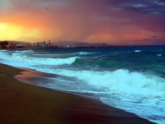 Neon blue waters - Barcelona Beach by Ananda Niyogi, via Flickr