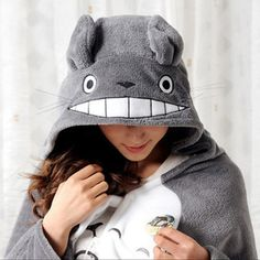 Your Neighbor Totoro will always smile, keeping you warm! The My Neighbor Totoro Blanket is a warm, plush shawl that features the title character of the popular
