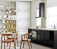 Small kitchen with dining and hidden shelving