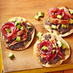 Get a taste of coastal Mexico with these tostadalike panuchos. Fried tortillas are piled high with a traditional blend of chicken, black beans, and pickled onions for a flavor combo that's as simple as it is delicious. Mexican Chicken Tacos, Mexican Shredded Chicken, Mexican Chicken Recipes, Shredded Chicken Recipes, Easy Chicken Recipes, Bhg Recipes, Cooking Recipes, Healthy Recipes, Vegetarian Recipes