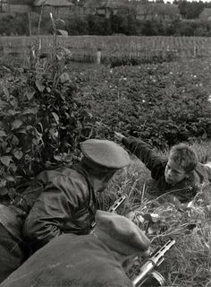 Boy reports to the commander of the 11th squad 3rd Leningrad Partisan Brigade G.V. Gvozdev about the location the Germans.