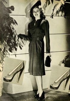 This style winner of magpie blue wool worn by Rita Hayworth would give an autumn girl ideas. It has a modified 'peg-top drape'; the neck is trimmed with a single twist of self material and two rows of the twist accent the shoulder broadness, The self belt has a clever gold trim! Rita's pumps are a real Paris fashion shoe for your tailored life!