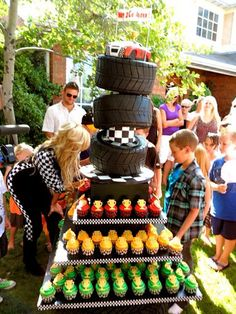 The cake was on a turntable so the tires looked like they were rolling around on each other and the mp3 player was playing race car sounds. Then there was a traffic light that blinked up and down the 3 tiers of the cupcake stand.