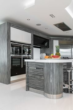 Caleidolegno island to modern kitchen with stainless steel from Herrington Gate