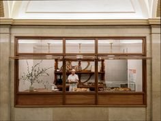 Neatly situated within the lobby of the historical Merchants Square Building in New York City's Tribeca area, the wafting aromas emanating from the Arcade Bakery fill the air with the mouth-watering scents of freshly baked goodness. Completed in mid 2014, by Brooklyn based architecture and interior design studio, Workstead, the quaint and charming bakery was conceived as a series of interventions within the context of the existing space.