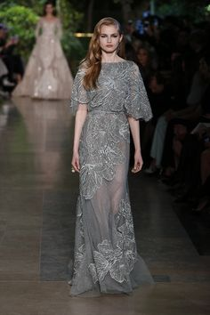 Spring/ Summer 2015: I love the grey color with the floral embroidery and embellishments. The flowy short sleeves give it an ethereal look.