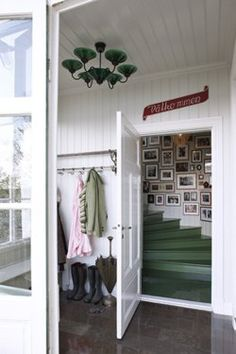 eek ! so cute. love those green stairs and the collage on the wall.