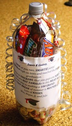 You'll need: 2 liter soda bottle, label removed, cleaned out, and a slit cut in the center to insert the candy. Candy: Kisses Skor 100 Grand Snickers Nerd Smarties Hot Tamales Milky Way Fast Brea...