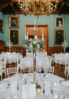 Flower dressed candelabra with Avalanche rose. A elegant winter wedding table centrepiece at Knowsley Hall captured by Embee photography.