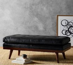 "Carson Tufted Leather Ottoman | Pottery Barn - $799: Big on comfort and style, our ottoman is topped with rich, top-grain leather wrapped over a generous cushion. Piping details along the edges and flared legs in an Espresso stain add an updated feel. 50.5"" wide x 22.5"" deep x 18.5"" high Made of kiln-dried hardwood."