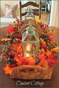 Thanksgiving table centerpiece: lanterns, leaves, basket (Fall)