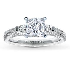 Important things for a certain someone to know :D ...*princess cut *skinny band *simple-ish, but i love the baby diamonds down the edges!