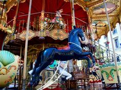 Merry-go-round in old city center of Marseille, France.  It looks like there are two levels - I wonder if that is the case?