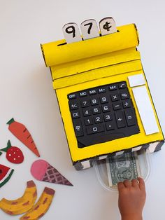 wondering what to do with that old school calculator? make an adorsable diy cardboard cash register.  {via handmade charlotte}