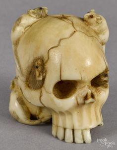 "Japanese carved ivory netsuke, late 19th c., in the form of rats crawling around a human skull, 1 3/8"" h."