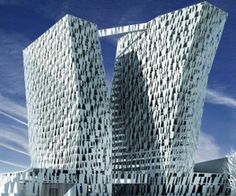 The Bella Sky hotel project in Copenhagen, Denmark, designed by 3XN, features two towers inclining in opposite directions, with facades breaking off during the rise.