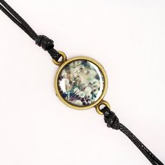 Items similar to Jupiter Nebula Cord Bracelet, Outer System Galaxy Jewelry, Handmade Black Cord Bracelet, Glass Dome, Choice Of Bezel Color on Etsy Cord Bracelets, Silver Bracelets, Galaxy Jewelry, White Clocks, Bronze, Cameo Pendant, Classic Gold, Glass Domes, Girl Gifts