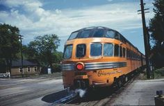 The eastbound Olympian Hiawatha pauses in La Crosse, WI, May 30, 1954, on its way to Milwaukee and Chicago. Brooks Stevens designed the train, including the signature Skytop Lounge. Stevens was a noted industrial designer with national credentials. The Milwaukee Road commissioned him to redesign the post-WW II Hiawathas, which had been first streamlined in 1935. Pullman built the parlor-sleeping cars for the Olympian Hiawatha, and the Milwaukee Road built the parlor-only Skytop Lounge cars.