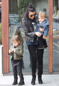 So hip: Penelope, three, wore a very trendy army green leather jacket and black leather look trousers for the outing