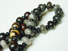 Agate and Onyx Bracelets by: https://www.etsy.com/shop/minxandmaven?section_id=12778430&ref=shopsection_leftnav_1
