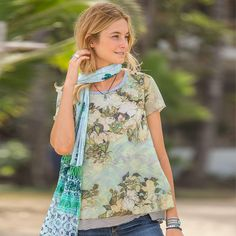 "BEAUX ARTS TOP -- The surprising combination of stripes and ethereal, watercolor blossoms makes an artistic statement in this easy, A-line top with merrow stitch accents and mesh overlay. Polyester/rayon/spandex. Machine wash. Made in USA of imported fabric. Exclusive. Sizes XS (2), S (4 to 6), M (8 to 10), L (12 to 14), XL (16). Approx. 25""L."