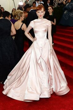 The 21 Best Looks From The Met Ball #refinery29  http://www.refinery29.com/2014/05/67370/met-gala-best-dressed-2014#slide8  We saw a lot of Champagne and bubble-gum pink this evening, but for this writer's money, Karen Elson's midcentury-inspired stunner was the finest of the candy-colored lot. Its interplay of softness and structure — not to mention its striking contrast with her hair — made it one of the night's standouts.