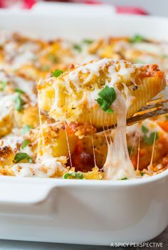 Rich cheesy Chicken Parmesan Stuffed Shells Recipe - A dynamic duo of classic chicken parmagiana and stuffed pasta shells!