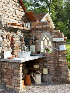 Great repurposed arched window in potting space..