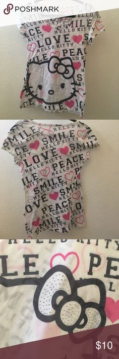 Hello Kitty T-Shirt This t-shirt is super comfy and has a cute Hello Kitty design! Gently used condition Hello Kitty Tops Tees - Short Sleeve