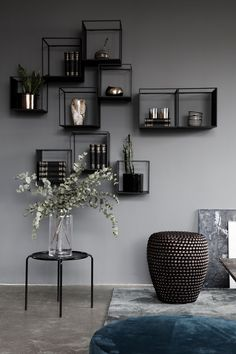 Modern decoration. Grey walls and small glass cabinets