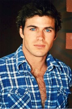 Blue eyes, squared off jaw, plaid shirt, chest hair... You sexy beast you! ;)