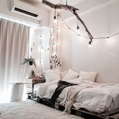 Coziness - fairy lights are life. Love how this uses readily available and inexpensive touches to enhance the entire room. #bedroomgoals #cozy #cuterooms