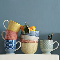 Modernist Collection from West Elm, bowls and mugs. I have the grey flowered bowl and the yellow mug!