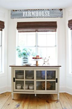 Dining room storage with adjustable shelves and beautiful glass front doors. This would be great an office or tv. I am loving it in the dining room it's from found at Walmart Repurposed Furniture, Painted Furniture, Bedroom Furniture, Diy Furniture, Farmhouse Furniture, Farmhouse Decor, Farmhouse Style, French Farmhouse, Farmhouse Ideas